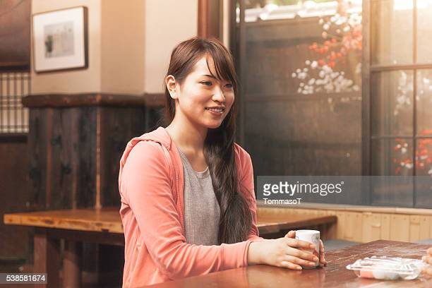 Young woman in a traditional tea house in Japan