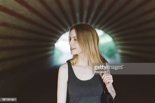 Young woman in a tunnel