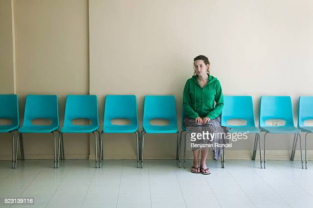 young woman in a waiting room - wartezimmer stock-fotos und bilder