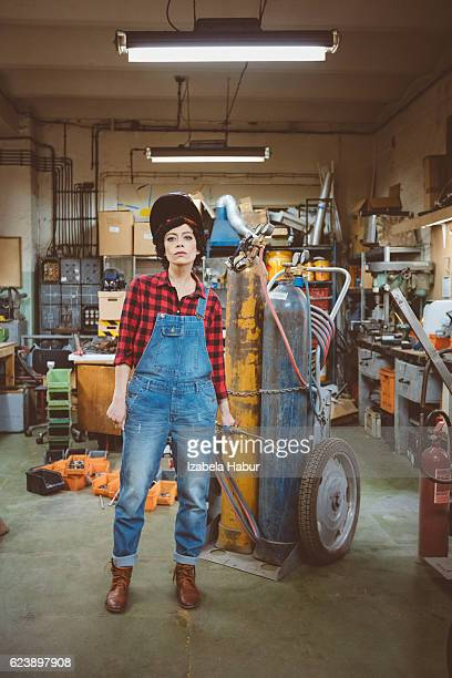 Young woman in a weld workshop