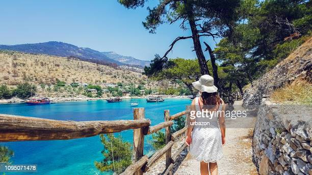 young woman in aliki beach - mediterranean sea stock pictures, royalty-free photos & images