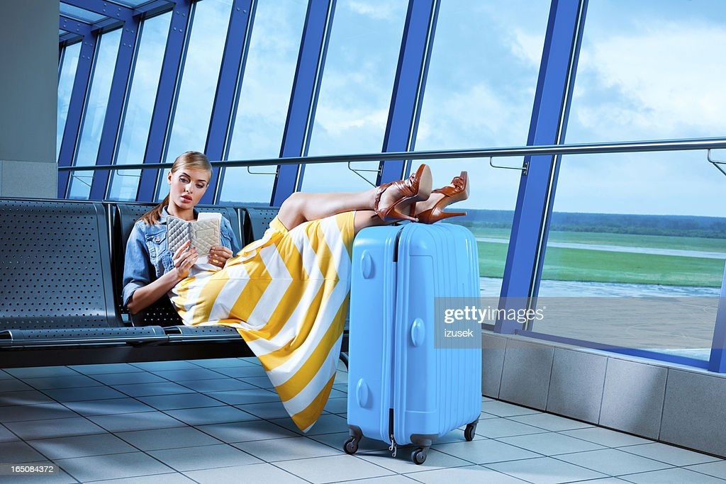 Young woman in an airport lounge : Stock Photo