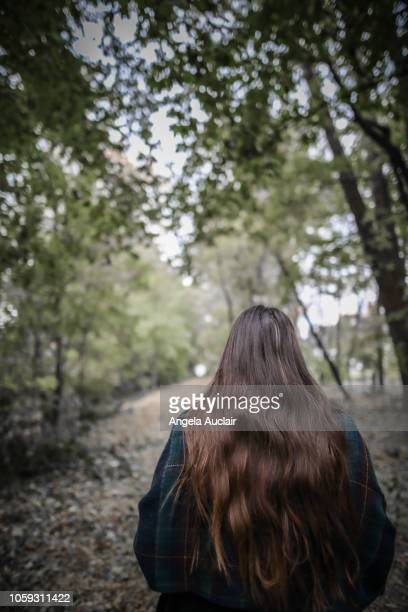 Young Woman in an Autumn Forest