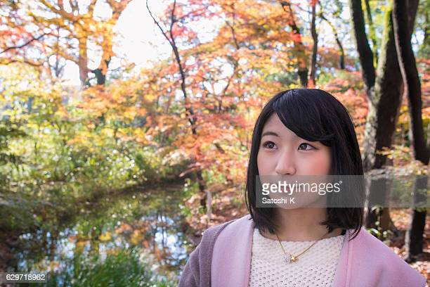 Young woman in autumn foliage