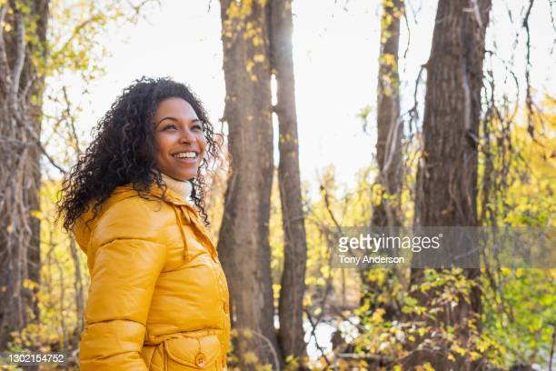 young woman in autumn woods - nature stock pictures, royalty-free photos & images