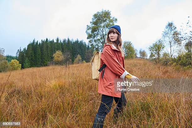 Young woman in autumnal landscape