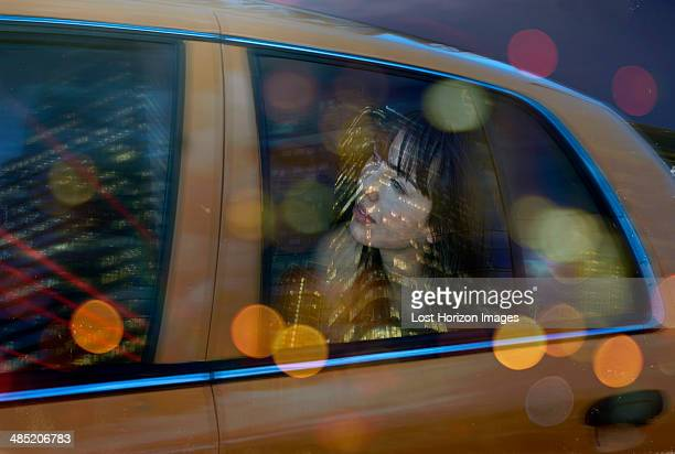 young woman in back of taxi - taxi foto e immagini stock
