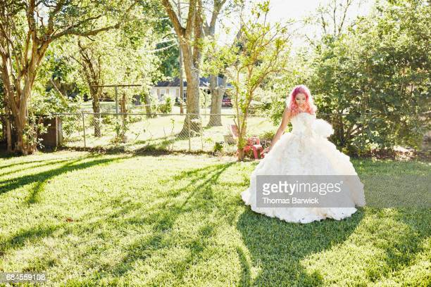 young woman in backyard dressed in quinceanera gown - 14 15 anni foto e immagini stock