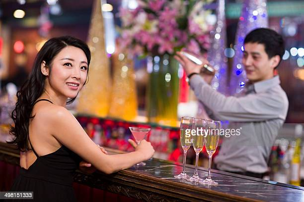 Young woman in bar