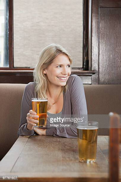 young woman in bar - borough of lewisham stock pictures, royalty-free photos & images