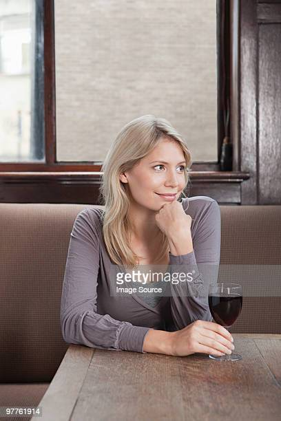 young woman in bar with red wine - borough of lewisham stock pictures, royalty-free photos & images