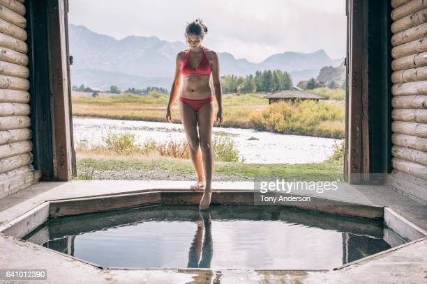 Young woman in bathing suit at mountain hot springs