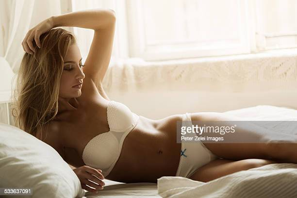 young woman in bed - pants stock photos and pictures
