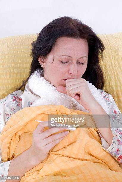 Young woman in bed with fever