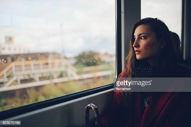 Young woman in Berlin metro train
