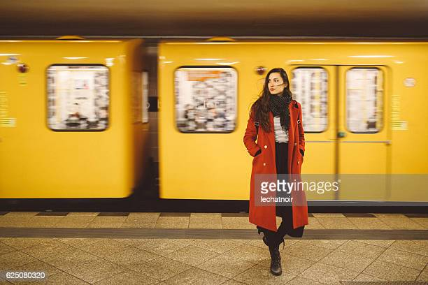 young woman in berlin subway station - kreuzberg stock photos and pictures