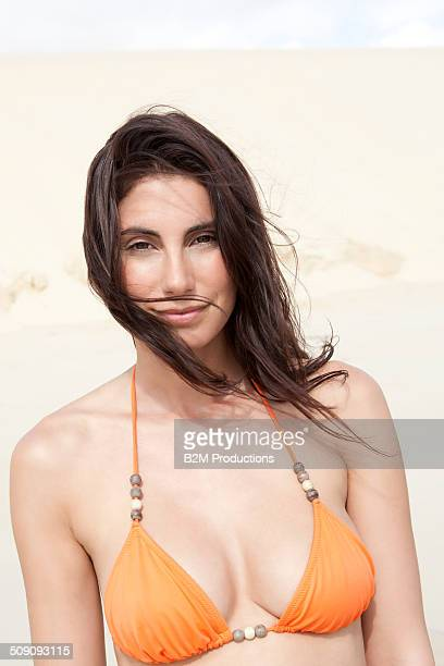 Young Woman In Bikini At Beach