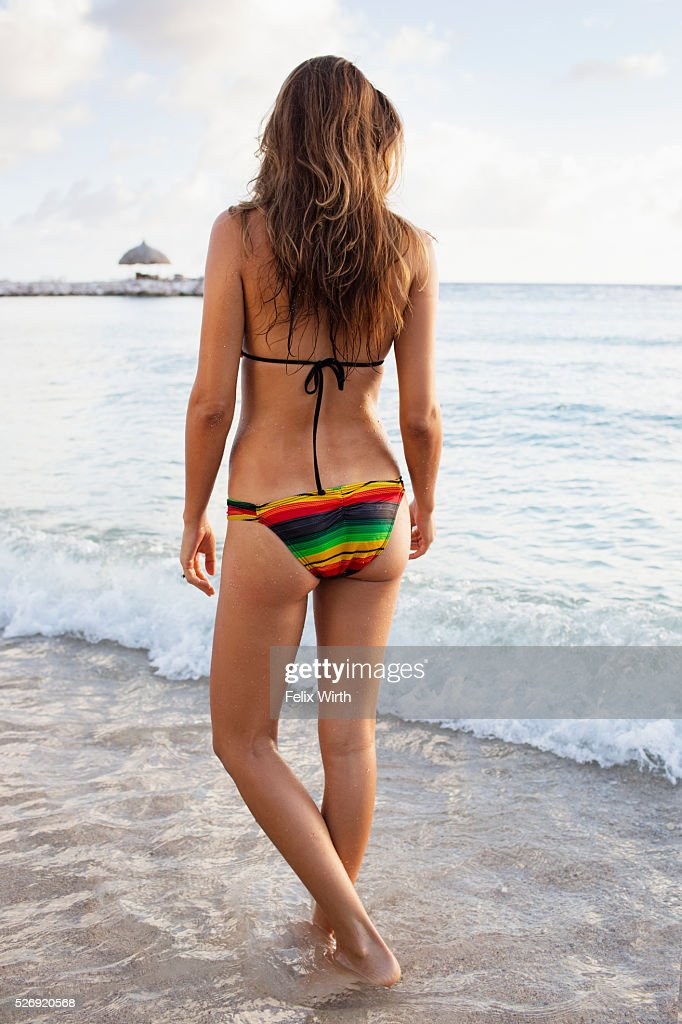 Young woman in bikini bathing in sea : Stock Photo