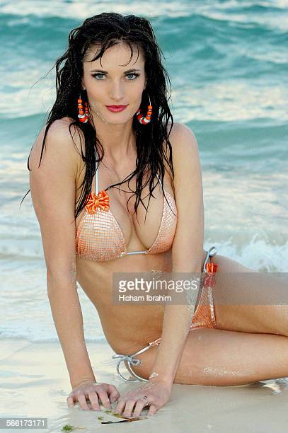 young woman in bikini on the beach - freeport bahamas stock photos and pictures