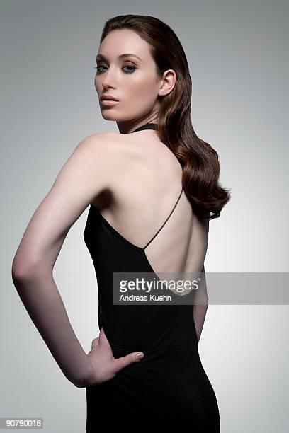 young woman in black dress, portrait. - イブニングウェア ストックフォトと画像