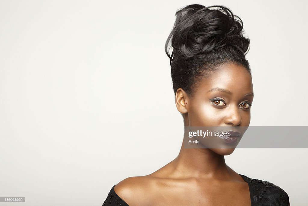 Young woman in black evening dress : Stock Photo