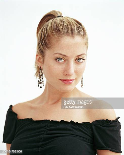 young woman in black top, portrait - ponytail stock pictures, royalty-free photos & images