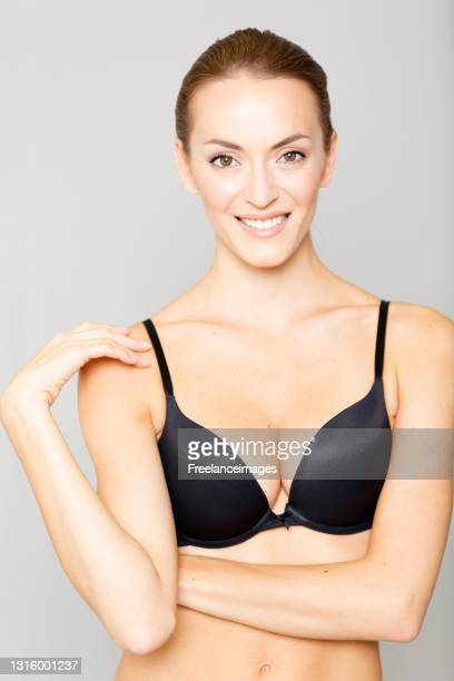young woman in black underwear on an isolated background smiling - full body isolated photos et images de collection