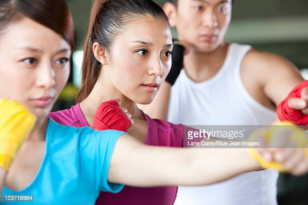 Young Woman in Boxing Class