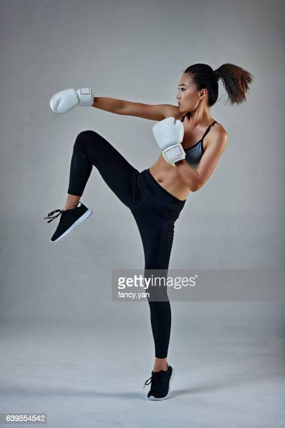 young woman in boxing gloves - boxing gloves stock photos and pictures
