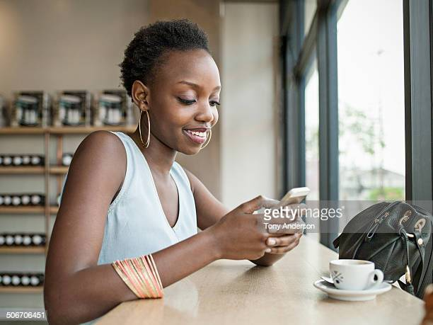 Young woman in café with mobile phone