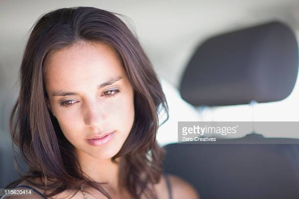 young woman in car - vulnerability stock pictures, royalty-free photos & images