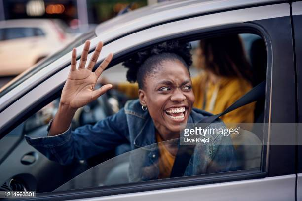young woman in car - driver stock pictures, royalty-free photos & images