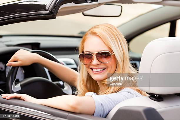young woman in car - prestige car stock pictures, royalty-free photos & images