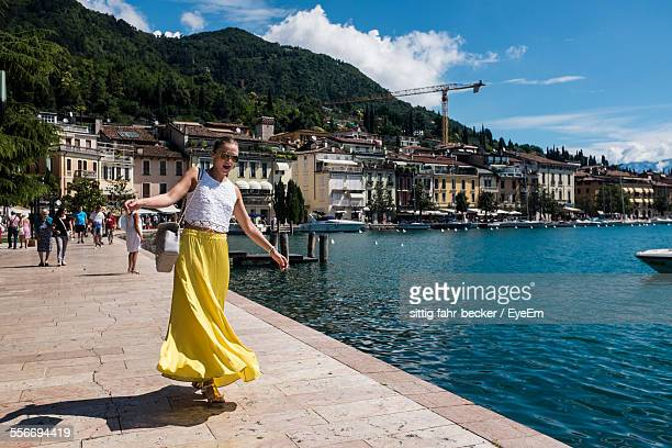 Young Woman In Casual Clothing Walking On Harbor