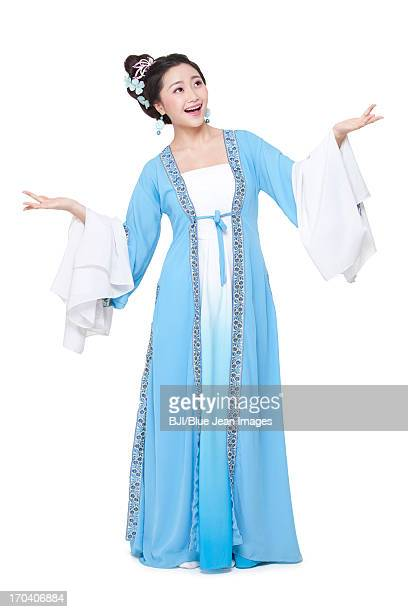 Young woman in Chinese traditional costume gesturing