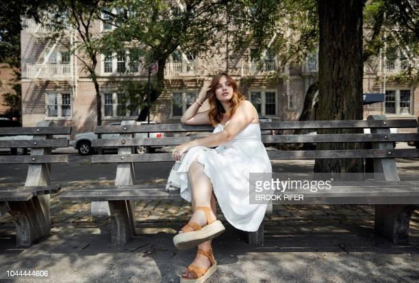 young woman in city - sandale stock-fotos und bilder