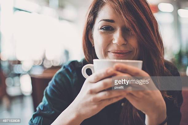 Young woman in coffee shop