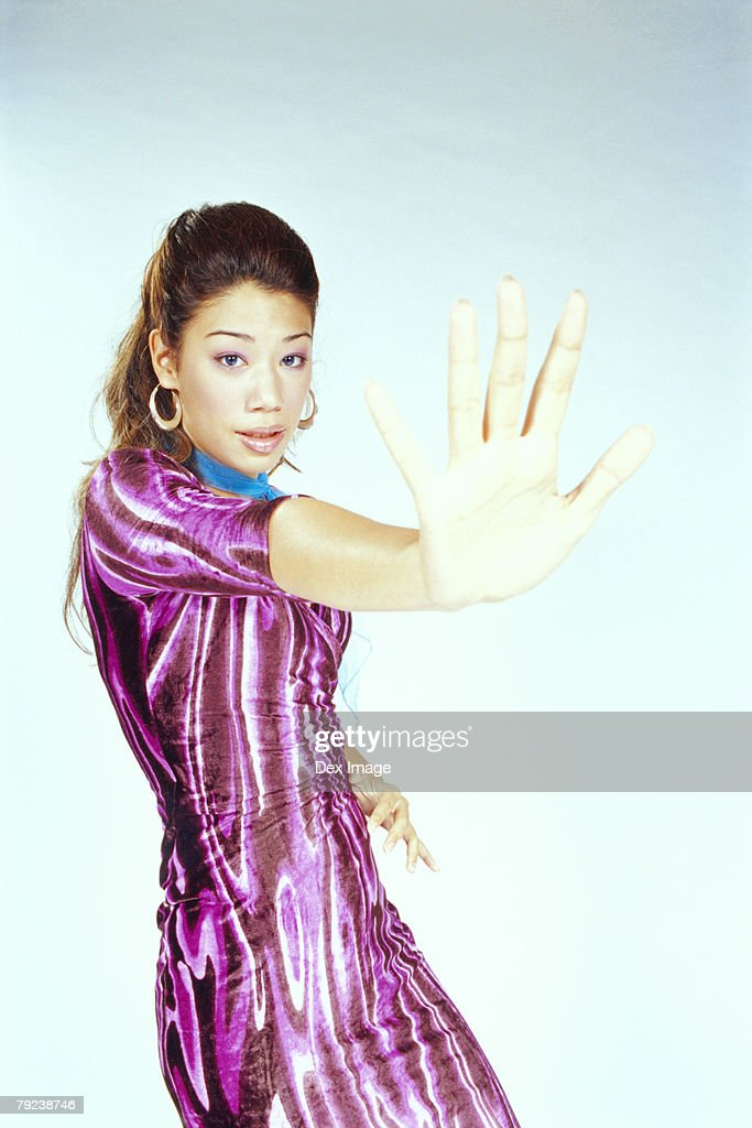 Young woman in dancing pose : Stock Photo
