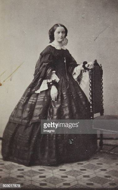 Young woman in dark dress The left hand on the back of a studio chair Full figure About 1860 Photograph by Carl von Jagemann / Vienna Photograph...