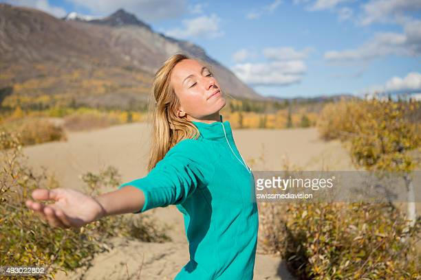 young woman in desert arms oustretched enjoying nature - non urban scene stock pictures, royalty-free photos & images