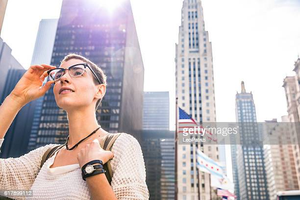 Young woman in downtown Chicago against US flag