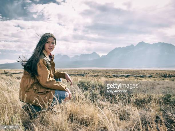 Young woman in dramatic mountain landscape