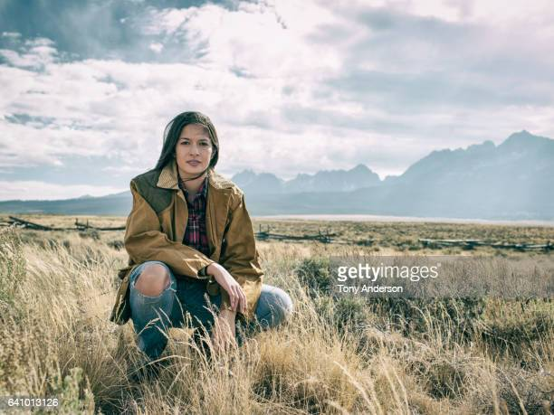 young woman in dramatic mountain landscape - environmentalist stock pictures, royalty-free photos & images