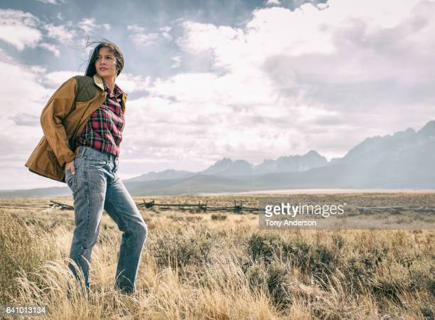 young woman in dramatic mountain landscape - wilderness stock pictures, royalty-free photos & images