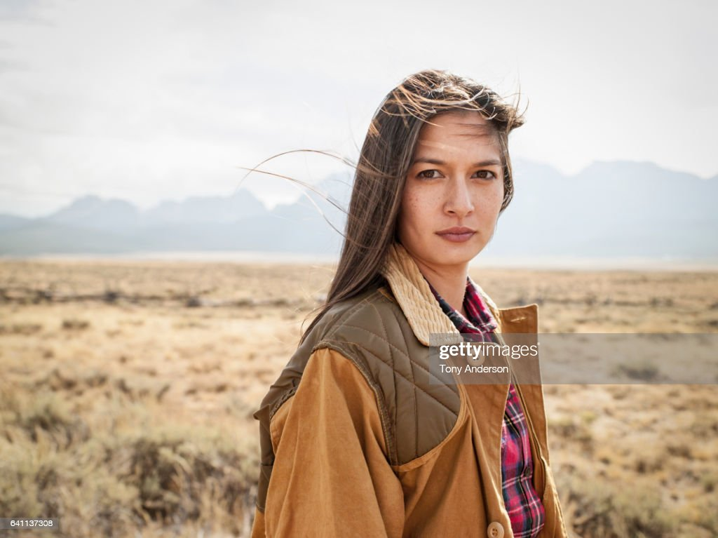 Young woman in dramatic mountain landscape : Stock Photo