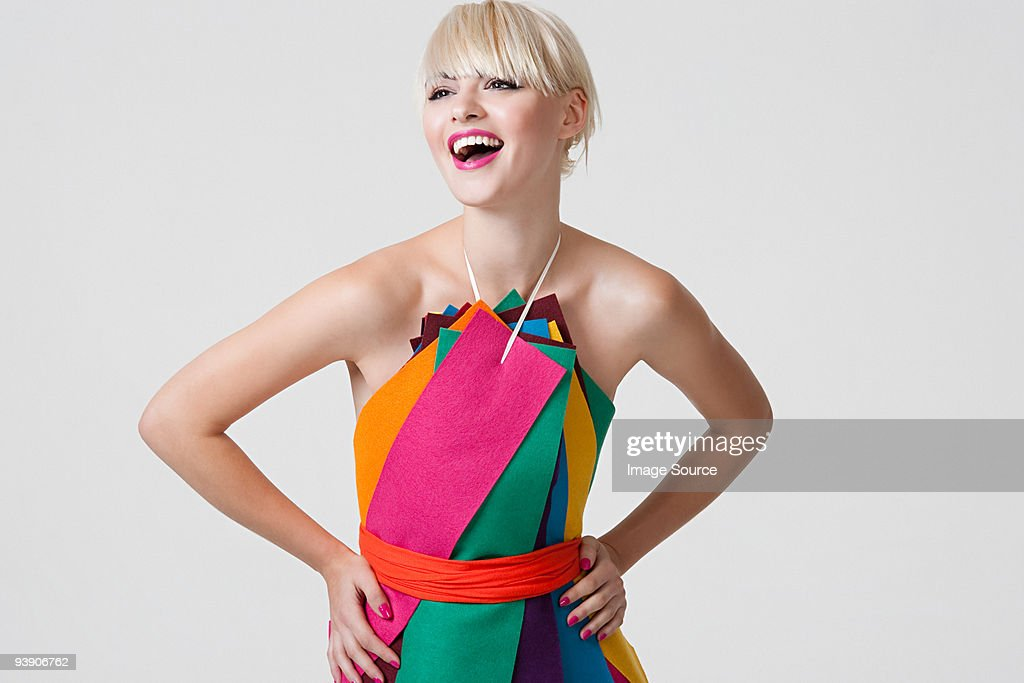 Young woman in dress made of coloured ribbons : Stock Photo