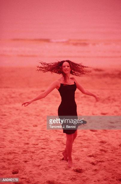 young woman in dress, on the beach - bavosi stock photos and pictures