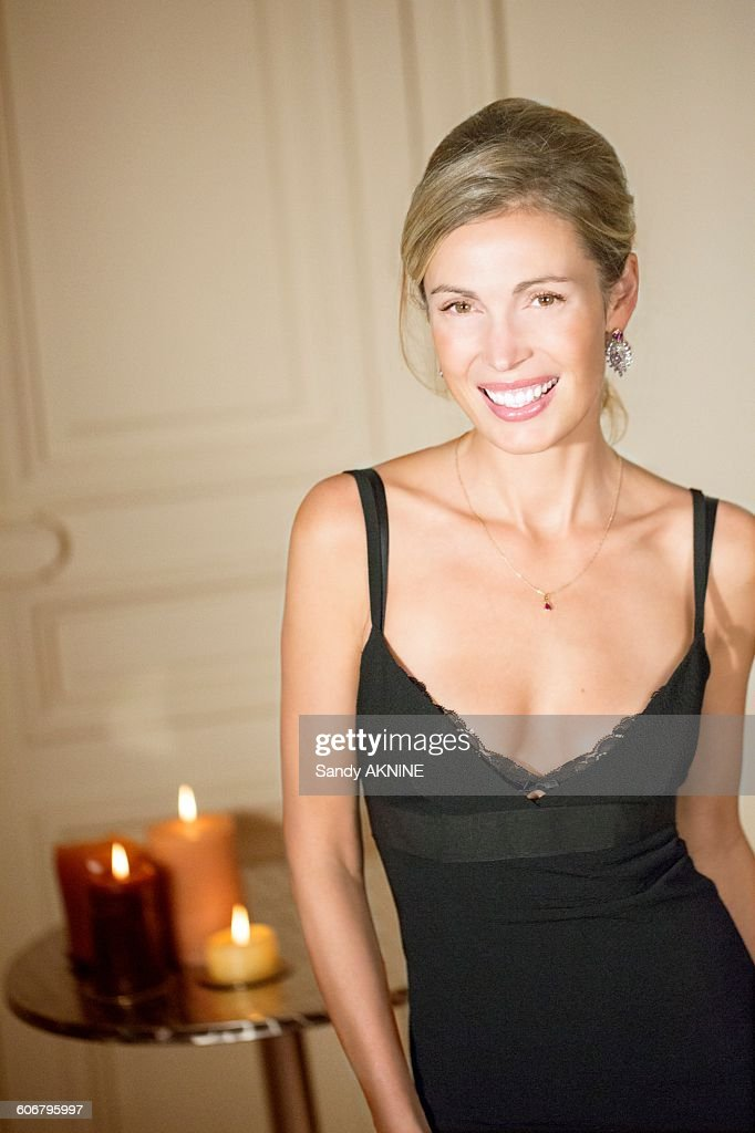 Young woman in evening dress : Stock Photo
