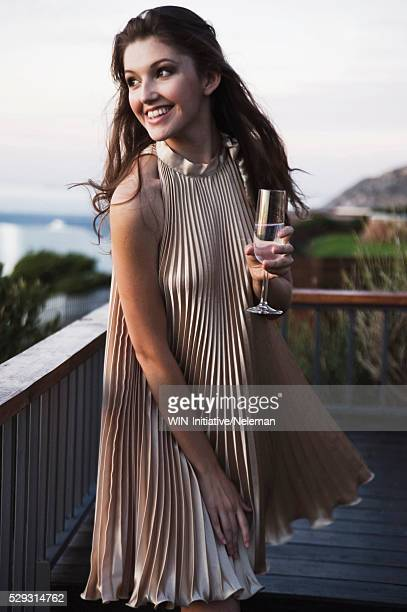 Young woman in evening dress with glass of champagne