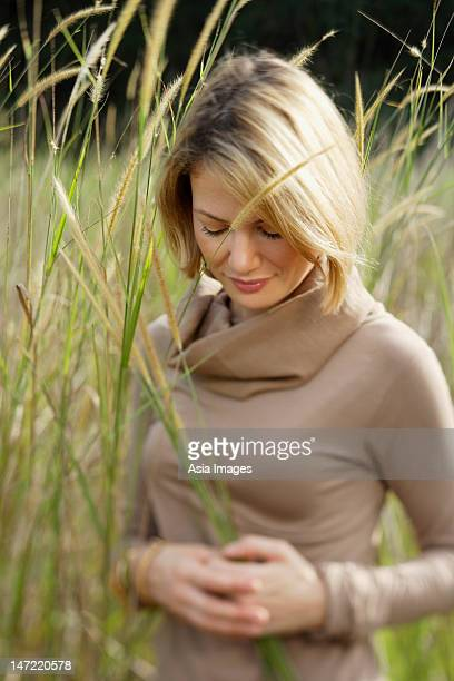 young woman in field